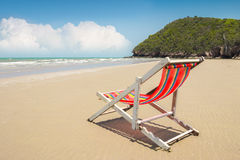 Beach chair on the beach and mountain with cloud and blue sky sc Stock Photography