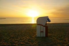 Beach chair on the beach at sunrise royalty free stock photography
