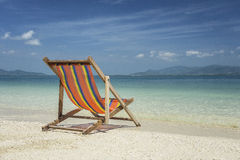 Beach chair at beach in thailand. Beach chair at sunny beach in thailand royalty free stock photos