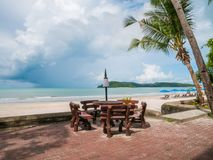 Beach Chair and Beach Umbrella Coconut Tree on The Beach. Beach Chair and Umbrella with view Coconut Tree on The Beach. Located in Cenang Beach Langkawi Malaysia stock photos