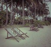 Beach chair on beach in vintage effect Stock Photos