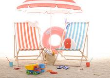 Beach chair with colorful sand toys Royalty Free Stock Photos