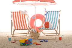 Beach chair with colorful sand toys Stock Photography