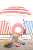 Beach chair with colorful sand toys Royalty Free Stock Image