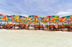Beach chair and colorful umbrella Royalty Free Stock Photos
