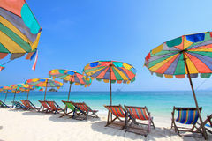 Beach chair and colorful umbrella on the beach Royalty Free Stock Image