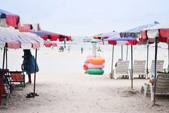 Beach chair and colorful umbrella on the beach stock image