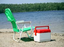 Beach chair and cooler. Beach scene with beach chair and cooler royalty free stock photo
