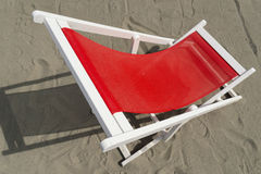 Beach chair. Empty red chair on the sand Stock Photo
