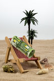 Beach chair with euro banknote Royalty Free Stock Photography