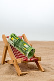 Beach chair with euro bill Royalty Free Stock Image