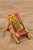 Beach chair with euro bill Stock Photos