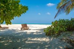 Beach chair facing the ocean and white sandy beach Stock Image