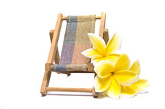 Beach chair and frangipani flower Royalty Free Stock Photo