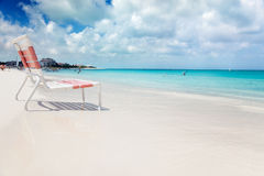 Beach chair in Grace Bay. Low beach chair in the edge of the calm turquoise waters of Grace Bay, Turks & Caicos stock photography