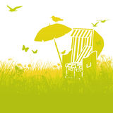 Beach chair in the grass and summer Stock Images