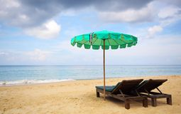 Beach chair and green umbrella Royalty Free Stock Photos