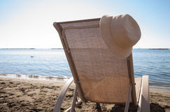Beach chair and a hat Stock Photography