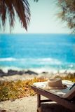 Beach chair on idyllic tropical palm beach, Tropical vacations concept Royalty Free Stock Images
