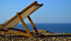 Beach Chair. Lounge chair on top of a hill overlooking the Pacific Ocean in Mancora, Peru royalty free stock image