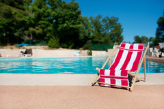 Beach chair near swimming pool Stock Photos