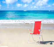Beach chair by the ocean Royalty Free Stock Photos