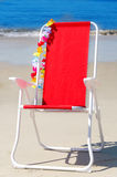 Beach chair by the ocean Stock Photo