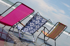 Rainbow beach chair on the ocean shore Royalty Free Stock Image