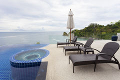 Beach chair in outdoor with swimming pool and sea view andaman s Stock Photo