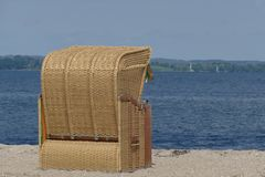 Beach chair overlooking the water Royalty Free Stock Photography