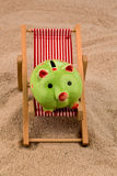 Beach chair with piggy bank Royalty Free Stock Images