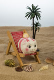 Beach chair with piggy bank and euro Stock Images