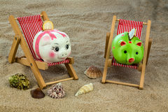 Beach chair with piggy bank and euro Royalty Free Stock Image