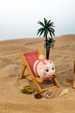 Beach chair with piggy bank and euro Royalty Free Stock Photo