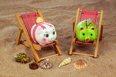 Beach chair with piggy bank Stock Images