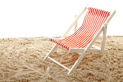 Beach chair on sand Stock Images