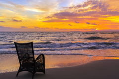 Beach chair on sand beach in sunset Royalty Free Stock Images