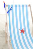 Beach chair in the sand Royalty Free Stock Image