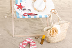 Beach chair in the sand Royalty Free Stock Photos