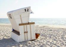 Beach Chair on sand at the ocean Royalty Free Stock Photos
