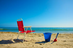 Beach Chair and Sand Pail Stock Photo