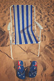 Beach chair and sandals Royalty Free Stock Photo