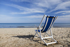 Beach chair on sandy beach. Royalty Free Stock Photo