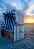 Beach chair on the sandy beach at sunset on the North Sea royalty free stock photo
