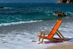 Beach chair in the sea Royalty Free Stock Photography
