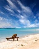 Beach chair on the seashore.Sea tropical landscape in a sunny day. Beach chair on the seashore stock image