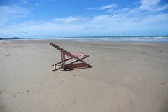 Beach chair on seashore Royalty Free Stock Images