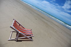 Beach chair on seashore Stock Photo