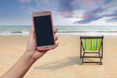 Beach chair and shadow on the white sand beach with sunset light. Sky lonely concept stock photo