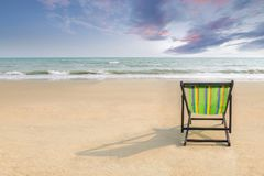 Beach chair and shadow on the white sand beach with sunset light. Sky lonely concept royalty free stock photos